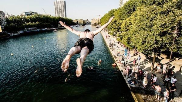 People swimming in the Bassin de la Villette, located in North-East Paris, in September 2016.