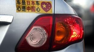 丰田车主在车尾贴文以示爱国心,摄于2012年10月16日。