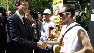 Arnaud Montebourg (L), Minister of Industrial Renewal, arrives to meet employees of the Fralib factory in Gemenos