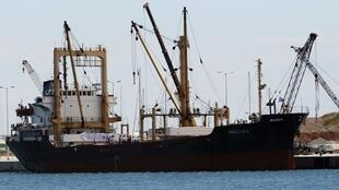 A cargo ship chartered by the Gadhafi International Charity and Development Foundation is loaded in Greece, on its way to Gaza