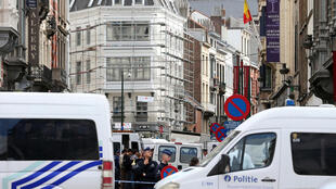 Police seal off the area around the Brussels Jewish Museum after the shooting