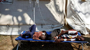 Patients await treatment at a makeshift cholera clinic in Harare on Tuesday