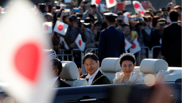 Japan's Emperor Naruhito and Empress Masako wave to well-wishers during their royal parade to mark the enthronement of Japanese Emperor Naruhito in Tokyo, Japan November 10, 2019.