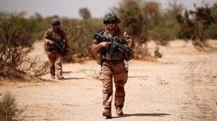 French soldiers conduct an area control operation as part of the Operation Barkhane counter-terrorism force in Mali, July 2019.
