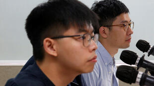 Joshua Wong (L)