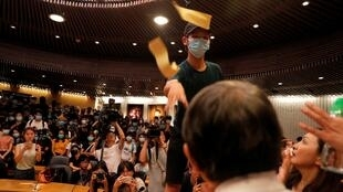 A demonstrator throws paper at Rocky Tuan, vice chancellor of Chinese University of Hong Kong, as the VC prepared to address demonstrators who entered an administrative building during a demo in solidarity with injured student Tsang, HK, 03 10 2019