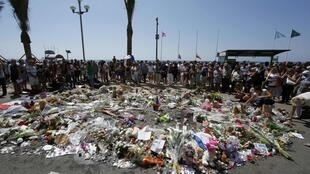 This file picture shows people gathered around a makeshift memorial to pay tribute to victims of the truck attack in Nice.