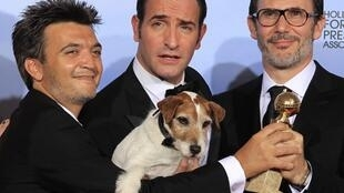 Producer Thomas Langmann (L), actor Jean Dujardin (C), and director Michel Hazanavicius with Uggie the dog