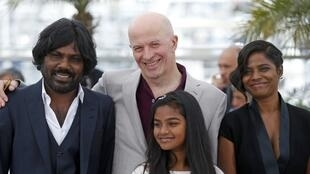 Actor Antonythasan Jesuthasan, director Jacques Audiard, actors Claudine Vinasithamby and Kalieaswari Srinivasan from the film Dheepan in competition at the 68th Cannes Film Festival in Cannes, 21 May 2015