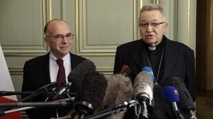 French Interior Minister Bernard Cazeneuve and Archbishop of Paris Cardinal André Vingt-Trois speak to the press after the discovery of a terrorist plot to attack a church in France