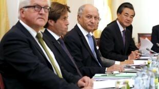 Министры иностранных дел Германии, Франции, Китая на переговорах по иранской ядерной программе, Вена, 6 июля 2015 г.
