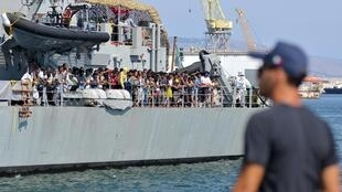 Rescued asylum-seekers about to disembark in port of Palermo, Sicily