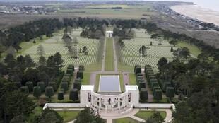 An aerial view shows the World War II Normandy American Cemetery and Memorial at Colleville sur Mer above Omaha Beach