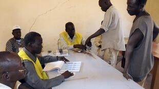 South Sudanese register to vote during the last day of registration in Khartoum, Sudan