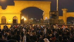 Fans face police in Cairo on Sunday