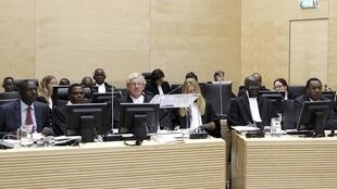 Kenya's former ministers sit in a courtroom of the ICC in The Hague