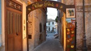 Welcome gate reads 'Global Village' in italian