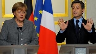France's President Nicolas Sarkozy and German Chancellor Angela Merkel at news conference in Paris,