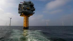 Power-generating windmill turbines at the Eneco Luchterduinen offshore wind farm near Amsterdam, Netherlands.