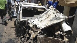 The wreckage of a car outside This Day's offices in Kaduna