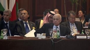Arab League Secretary General Nabil Elaraby (C) attends the Arab foreign ministers meeting in Cairo