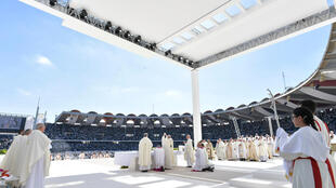 Pope Francis holds a mass at the Zayed Sports City Stadium in Abu Dhabi