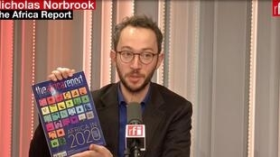Managing Editor Nicholas Norbrook with a copy of The Africa Report, Jan-Feb-March 2020.