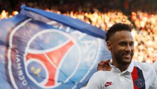 Paris St Germain's Neymar celebrates scoring their first goal against Strasbourg