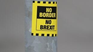 A sticker opposing Brexit is seen on a street in Londonderry, Northern Ireland.