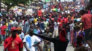 People march during a protest over a suspected effort by President Alpha Conde to seek a third term in Conakry, Guinea October 24, 2019.