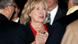 US Secretary of State Hillary Clinton is greeted by officials after arriving in Tunis on 17 March, 2011