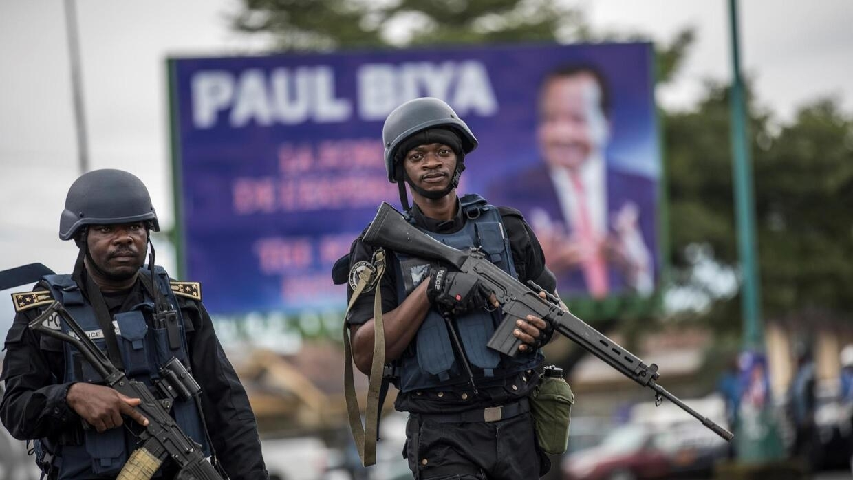 Cameroonian gendarmes patrol in the South West provincial capital Buea during a rally for President Paul Biya's ruling CPDM party, 3 October 2018.