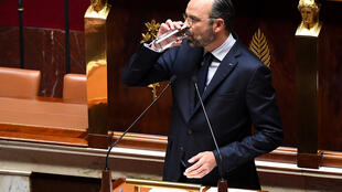 Thirsty work: French prime minister Edouard Philippe addressing the French parliament.