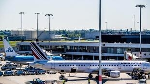 Air France and KLM aircrafts stand parked at Schiphol Airport, Netherlands