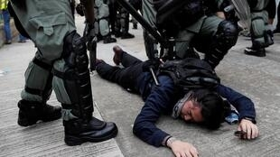 Hong Kong police arrest a protester in the city on the 24th August 2019.