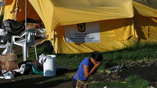 A Venezuelan migrant woman cries outside a tent in a temporary humanitarian camp that is closed by the government, in Bogota, Colombia January 15, 2019.