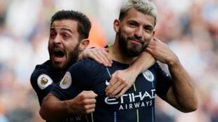 Sergio Aguero (right), who scored Manchester City's winner at Burnley, celebrates his goal with Bernardo Silva.