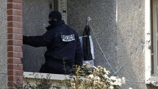 A policeman in the apartment of  Mohamed Merah in Toulouse.