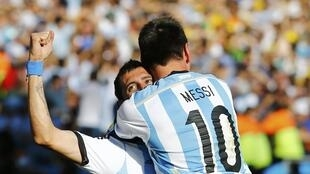 Argentina's Angel Di Maria celebrates after scoring a goal with teammate Lionel Messi in match against Switzerland