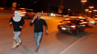 Protesters run for shelter after Bahraini security forces opened fire at protesters marching towards the Pearl Square in capital
