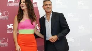 Os atores americanos Sandra Bullock e George Clooney durante a abertura do Festival de Cinema de Veneza, nesta quarta-feira, 28 de agosto de 2013.