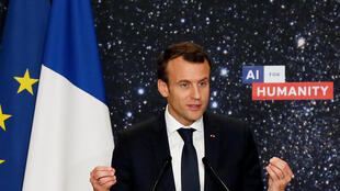 French President Emmanuel Macron delivers a speech during the Artificial Intelligence for Humanity event in Paris on March 29, 2018.