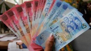 Le gouvernement ghanéen cherche à en capter une partie de l'argent des transferts de la diasporavia l'African Sankofo Account. Sur la photo : le cédi, la monnaie du Ghana. (Image d'illustration).