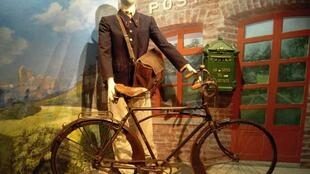 A dummy postman with bike