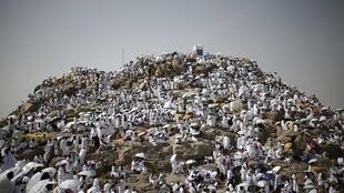 Muslim pilgrims visit Mount Mercy on the plains of Arafat during the annual hajj pilgrimage, outside the holy city of Mecca.