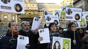 Colleagues and relatives of Ghislaine Dupont and Claude Verlon seek the truth  (pictured here at a memorial gathering in 2017).