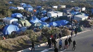"The ""new jungle"", a field where migrants and asylum seekers stay in Calais"