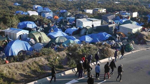 Tents for migrants in Calais, but even those asking for asylum to stay in France find it hard to stay off the street