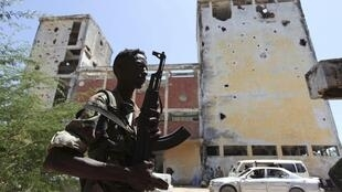 A Somali government soldier patrols the streets of capital Mogadishu, 22 February, 2012