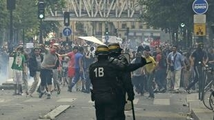 Demonstrators confront CRS riot police on the banned Gaza protest in Paris Saturday